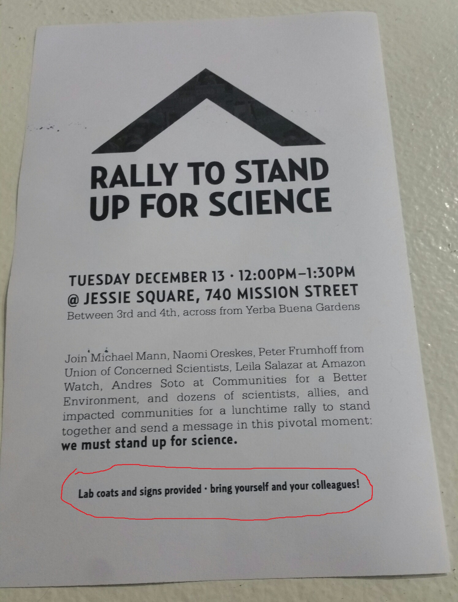 A poster advertising the rally and promising to provide lab coats and signs